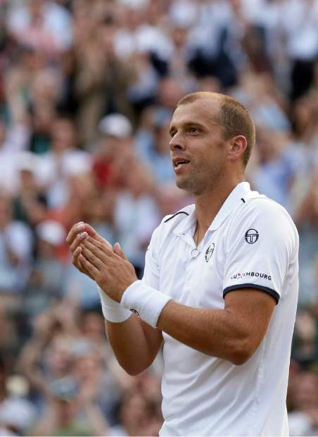 Luxembourg's Gilles Muller celebrates after beating Spain's Rafael Nadal in their Men's Singles Match on day seven at the Wimbledon Tennis Championships in London Monday, July 10, 2017. (AP Photo/Tim Ireland)