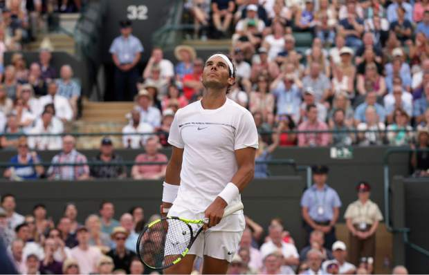 Spain's Rafael Nadal looks up as he plays Luxembourg's Gilles Muller during their Men's Singles Match on day seven at the Wimbledon Tennis Championships in London Monday.