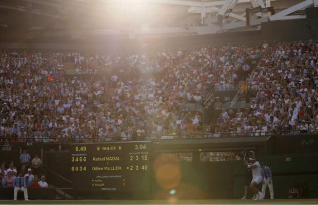 Spain's Rafael Nadal returns to Luxembourg's Gilles Muller during their Men's Singles Match on day seven at the Wimbledon Tennis Championships in London Monday, July 10, 2017. (AP Photo/Tim Ireland)