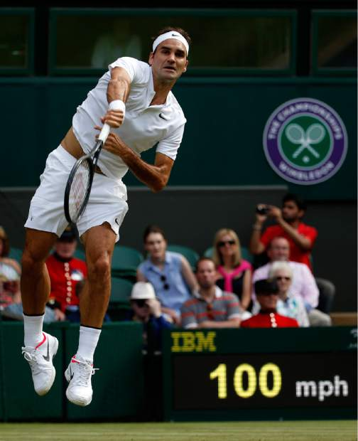 Roger Federer returns to Alexandr Dolgopolov during their match Tuesday at Wimbledon.
