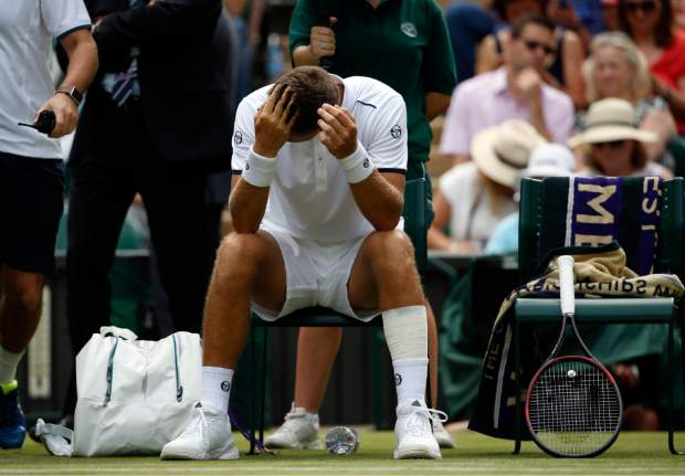 Martin Klizan gestures after receiving medical treatment during his match against Novak Djokovic on Tuesday.