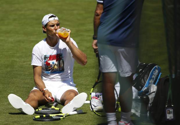 Spain's Rafael Nadal takes a break during a practice session ahead of the Wimbledon Tennis Championships in London, Sunday, July 2, 2017. (AP Photo/Alastair Grant)