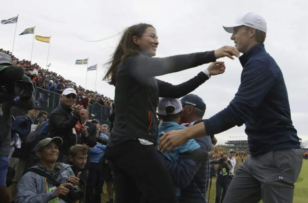 Winner Jordan Spieth of the United States is greeted by Sybi Kuchar, wife of runner up Matt Kuchar of the United States, after the final round of the British Open Golf Championship, at Royal Birkdale, Southport, England, Sunday July 23, 2017. (AP Photo/Dave Thompson)