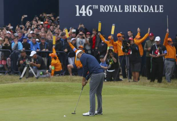 Jordan Spieth of the United States putts to win the British Open Golf Championship, at Royal Birkdale, Southport, England, Sunday July 23, 2017. (AP Photo/Dave Thompson)