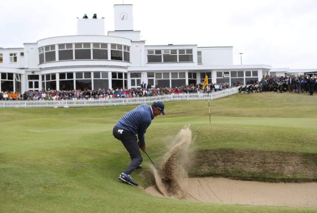 Matt Kuchar of the United States plays out of the bunker on the 18th hole during the final round of the British Open Golf Championship, at Royal Birkdale, Southport, England, Sunday July 23, 2017. (AP Photo/Peter Morrison)