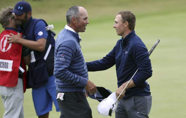 Jordan Spieth of the United States, right, is congratulated by Matt Kuchar of the United States after winning the British Open Golf Championships at Royal Birkdale, Southport, England, Sunday July 23, 2017. (AP Photo/Peter Morrison)