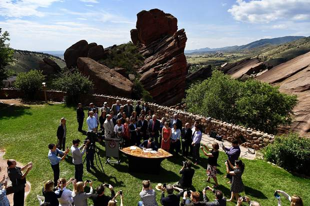 Gov. John Hickenlooper signed an executive order surrounding climate change at Red Rocks Park in Morrison, Colorado, on Tuesday morning. Doing so, he committed the state to reducing greenhouse gases by more than 26 percent by 2025, as well as cutting carbon dioxide emissions from the electricity sector by 25 percent by 2025, and 35 percent by 2035.