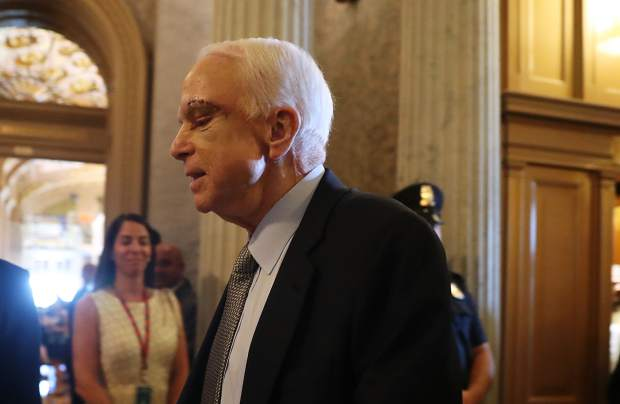 Sen. John McCain, R-Ariz. arrives on Capitol Hill in Washington Tuesday as the Senate was to vote on moving head on health care with the goal of erasing much of Barack Obama's Law.
