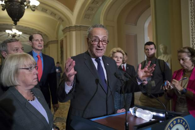 Seate Minority Leader Chuck Schumer, D-N.Y., joined from left by, Sen. Patty Murray, D-Wash., Sen. Dick Durbin, D-Ill., Sen. Ron Wyden, D-Ore., and Sen. Debbie Stabenow, D-Mich., speaks with reporters outside the chamber after Vice President Mike Pence broke a 50-50 tie to start debating Republican legislation to tear down much of the Obama health care law, on Capitol Hill in Washington, Tuesday, July 25, 2017. (AP Photo/J. Scott Applewhite)