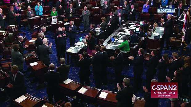 In this image from video provided by C-SPAN2, Sen. John McCain, R-Ariz. is embraced by Senate Minority Leader Charles Schumer of N.Y. as he arrives of the floor of the Senate on Capitol Hill in Washington, Tuesday, July 25, 2017. (C-SPAN2 via AP)
