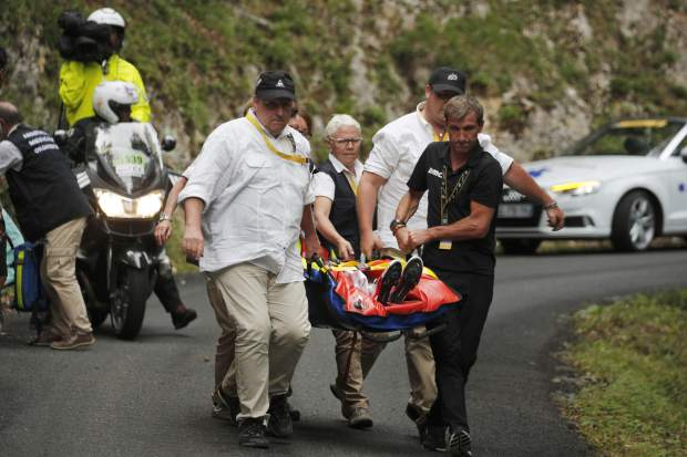 Australia's Richie Porte is carried to an ambulance after crashing in the descent of the Mont du Chat pass during the ninth stage of the Tour de France cycling race over 181.5 kilometers (112.8 miles) with start in Nantua and finish in Chambery, France, Sunday, July 9, 2017. (AP Photo/Christophe Ena)