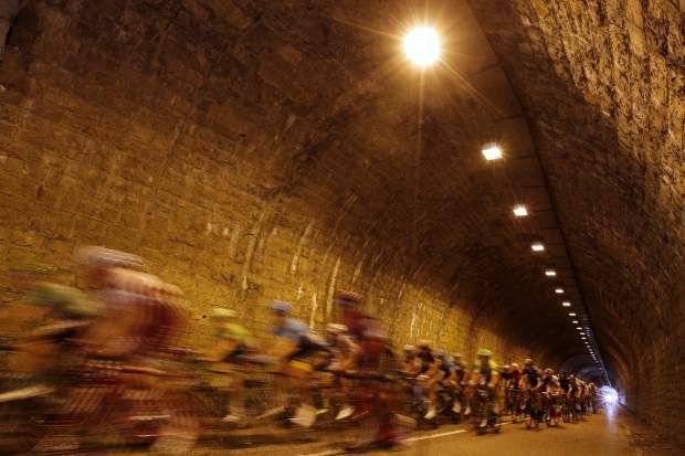 The pack passes through a tunnel during the ninth stage of the Tour de France cycling race over 181.5 kilometers (112.8 miles) with start in Nantua and finish in Chambery, France, Sunday, July 9, 2017. Mori's injury forced him to abandon the race. (AP Photo/Christophe Ena)