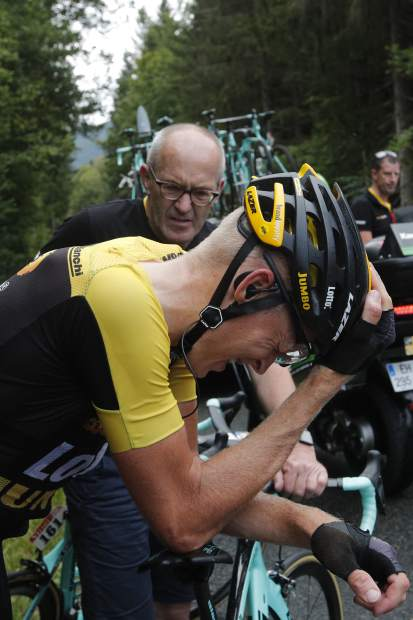Netherlands' Robert Gesink leans on his bicycle as he holds his head after crashing during the ninth stage of the Tour de France cycling race over 181.5 kilometers (112.8 miles) with start in Nantua and finish in Chambery, France, Sunday, July 9, 2017. Gesink's injuries forced him to abandon the race. (AP Photo/Christophe Ena)