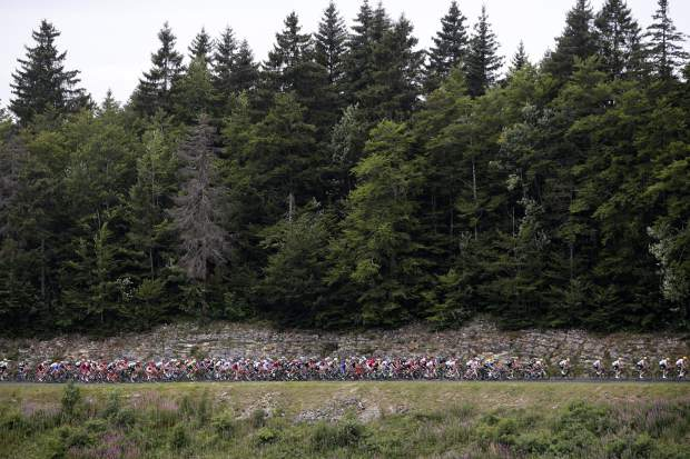 The pack rides during the ninth stage of the Tour de France cycling race over 181.5 kilometers (112.8 miles) with start in Nantua and finish in Chambery, France, Sunday, July 9, 2017. (AP Photo/Christophe Ena)