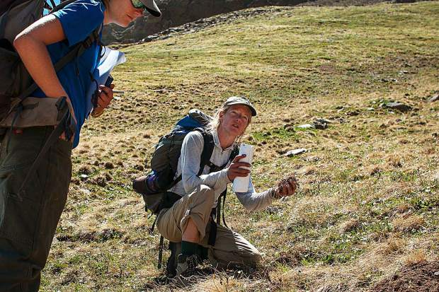 Loretta McEllhiney explains the key role pocket gophers play in soil distribution and seeding success for alpine plants before a trail crew begins construction on San Luis Peak.