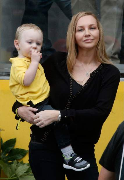 Britain's Chris Froome's wife Michelle and their son Kellan wait on the Champs Elysees avenue during the twenty-first and last stage of the Tour de France cycling race over 103 kilometers (64 miles) with start in Montgeron and finish in Paris, France, Sunday, July 23, 2017. (AP Photo/Thibault Camus)