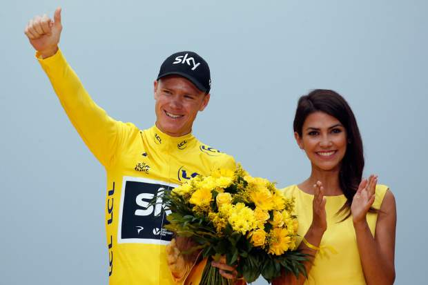 Tour de France winner Chris Froome gestures from the podium after the twenty-first and last stage of the Tour de France cycling race on Sunday.