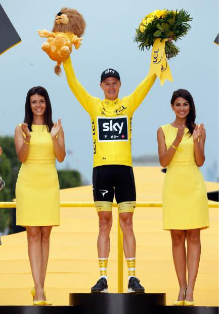 Tour de France winner Britain's Chris Froome, wearing the overall leader's yellow jersey, celebrates on the podium after the twenty-first and last stage of the Tour de France cycling race over 103 kilometers (64 miles) with start in Montgeron and finish in Paris, France, Sunday, July 23, 2017. (AP Photo/Thibault Camus)