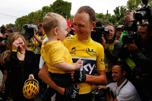 Tour de France winnerChris Froome, holds his son, Kellan, on Champs Elysees Avenue in Paris during the twenty-first and last stage of the Tour de France cycling race on Sunday.