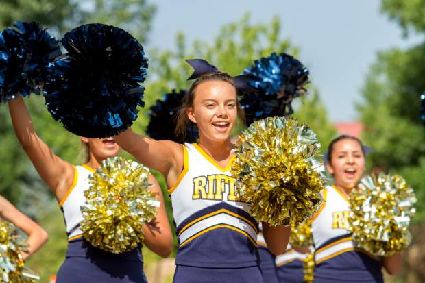 The Rifle High School Cheerleaders make their way down Grand Avenue during the Silt Heydays parade.