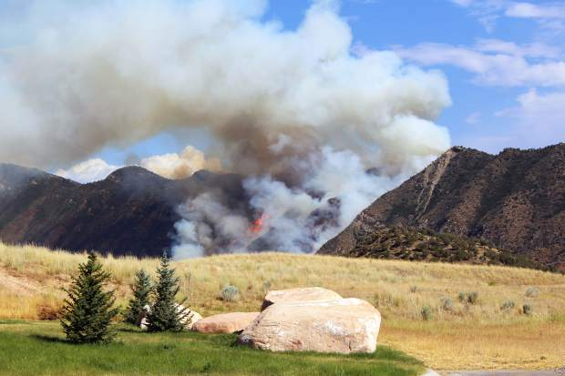 A fire that erupted on the Grand Hogback east of New Castle spread up the steep hillside quickly before firefighters from multiple agencies, along with air support, were able to get things under control.