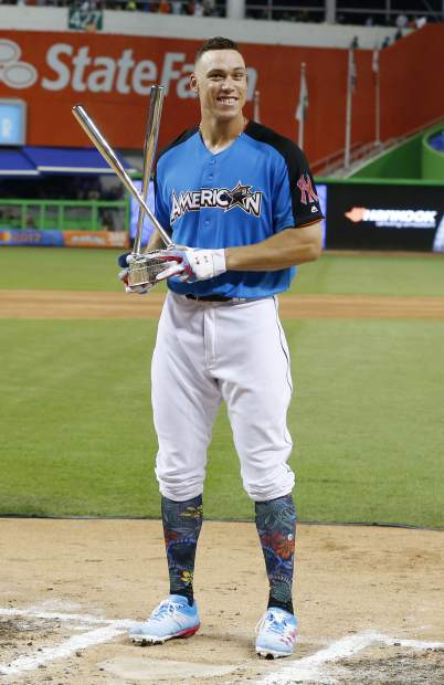 New York Yankees' Aaron Judge shows the trophy after winning the MLB baseball All-Star Home Run Derby, Monday, July 10, 2017, in Miami. (AP Photo/Wilfredo Lee)
