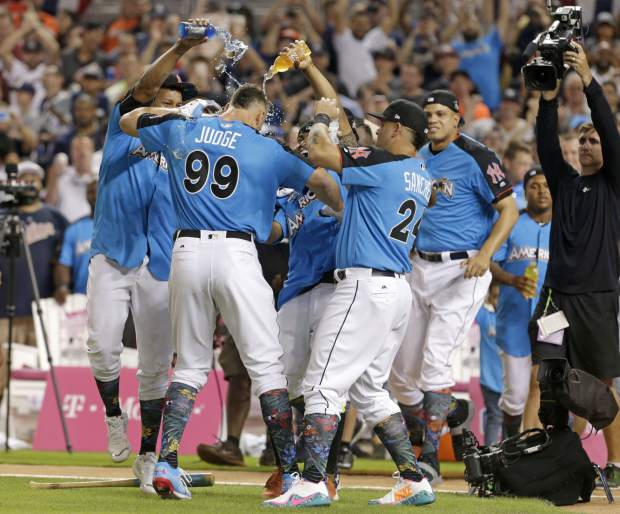 Teammates celebrate with New York Yankees' Aaron Judge (99) after winning the MLB baseball All-Star Home Run Derby, Monday, July 10, 2017, in Miami. (AP Photo/Lynne Sladky)