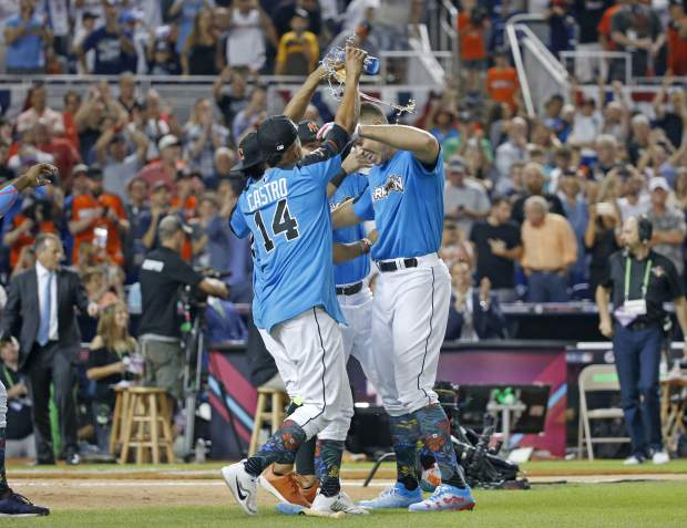 Teammates celebrate with New York Yankees' Aaron Judge, right, after winning the MLB baseball All-Star Home Run Derby, Monday, July 10, 2017, in Miami. (AP Photo/Wilfredo Lee)