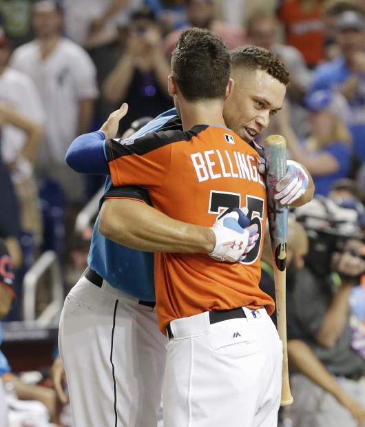 New York Yankees' Aaron Judge is hugged by Los Angeles Dodgers' Cody Bellinger (35) during the MLB baseball All-Star Home Run Derby, Monday, July 10, 2017, in Miami. (AP Photo/Lynne Sladky)