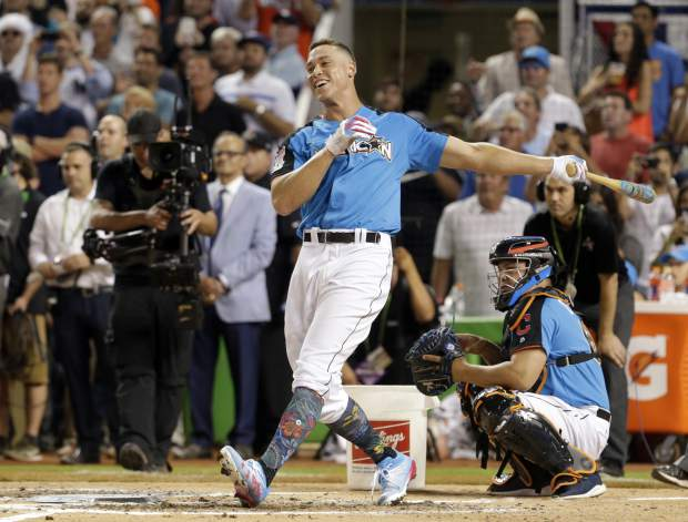New York Yankees' Aaron Judge smiles as he competes during the MLB baseball All-Star Home Run Derby, Monday, July 10, 2017, in Miami. (AP Photo/Lynne Sladky)