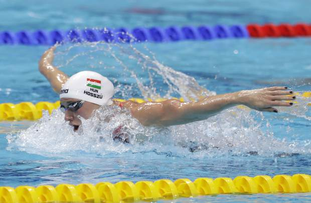 Hungary's gold medal winner Katinka Hosszu competes in the women's 400-meter individual medley final during the swimming competitions of the World Aquatics Championships in Budapest, Hungary, Sunday, July 30, 2017. (AP Photo/Petr David Josek)