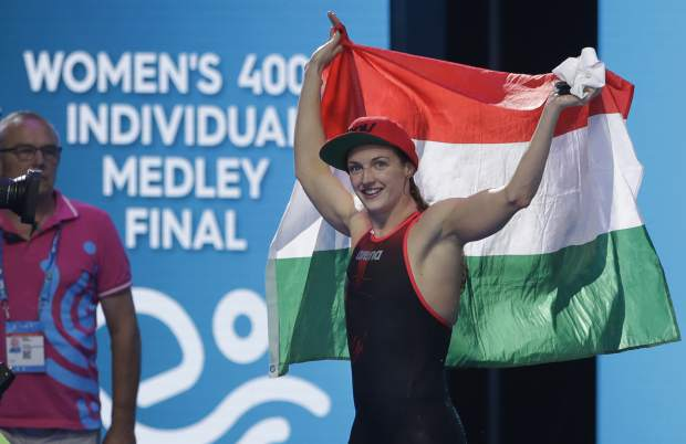 Hungary's Katinka Hosszu celebrates after winning the gold medal in the women's 400-meter individual medley final during the swimming competitions of the World Aquatics Championships in Budapest, Hungary, Sunday, July 30, 2017. (AP Photo/Petr David Josek)