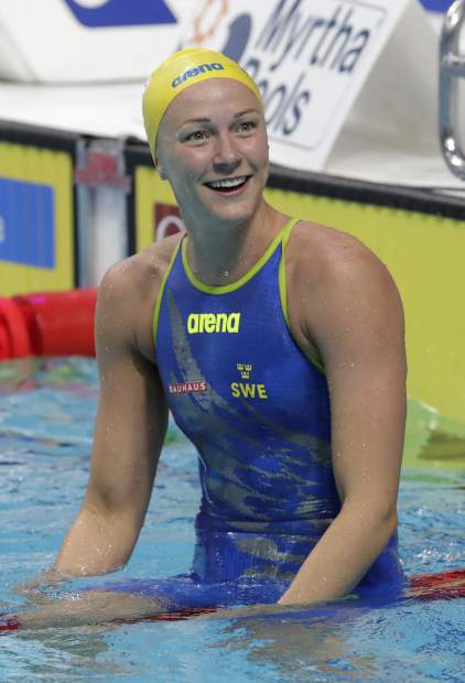 Sweden's Sarah Sjostrom celebrates after setting a new world record in a women's 50-meter freestyle semifinal during the swimming competitions of the World Aquatics Championships in Budapest, Hungary, Saturday, July 29, 2017. (AP Photo/Michael Sohn)