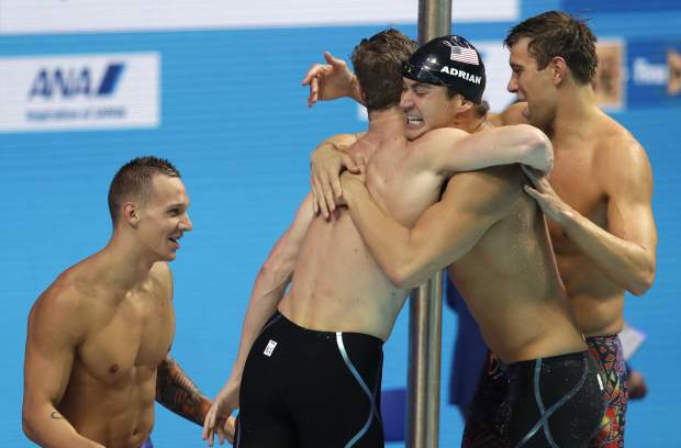 United States' Caeleb Dressel, Kevin Cordes, Nathan Adrian and Matt Grevers, from left, celebrate after winning the gold medal in the men's 4x100-meter medley relay final during the swimming competitions of the World Aquatics Championships in Budapest, Hungary, Sunday, July 30, 2017.