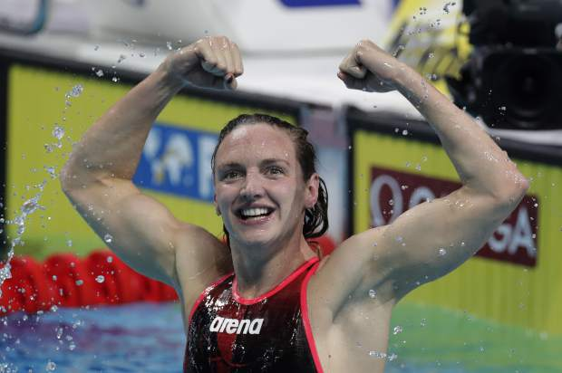 Hungary's Katinka Hosszu celebrates after winning the gold medal in the women's 400-meter individual medley final during the swimming competitions of the World Aquatics Championships in Budapest, Hungary, Sunday, July 30, 2017. (AP Photo/Michael Sohn)