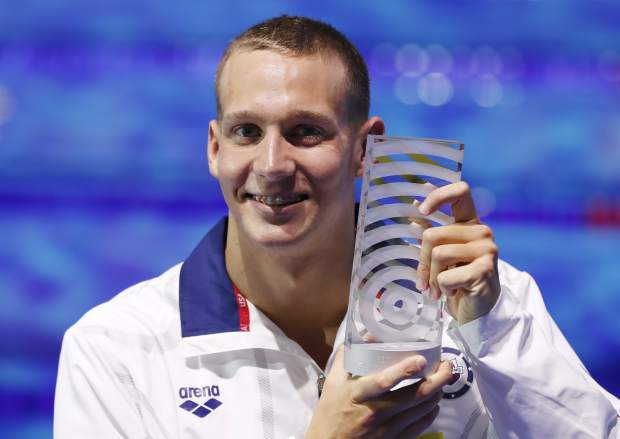 United States' Caeleb Remel Dressel who won 7 gold medals shows off the award as best male athlete during the swimming competitions of the World Aquatics Championships in Budapest, Hungary, Sunday, July 30, 2017. (AP Photo/Petr David Josek)