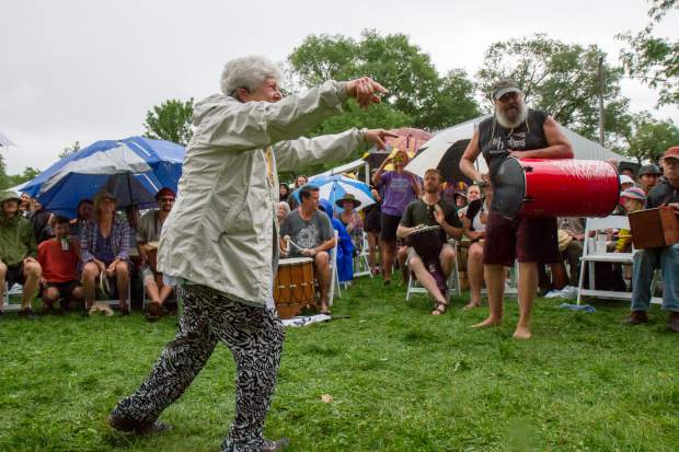 Laurie Loeb leads the Rhythm of the Heart Community Drum Circle at the opening ceremony of the 46th Annual Carbondale Mountain Fair.