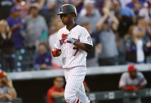 Colorado Rockies' Raimel Tapia circles the bases after hitting a solo home run off Cincinnati Reds starting pitcher Luis Castillo in the sixth inning of a baseball game Monday, July 3, 2017, in Denver. The Rockies won 5-3. (AP Photo/David Zalubowski)