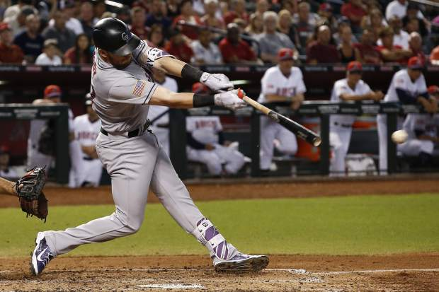 Colorado Rockies' Trevor Story connects for a run-scoring single against the Arizona Diamondbacks during the fourth inning of a baseball game Sunday, July 2, 2017, in Phoenix. (AP Photo/Ross D. Franklin)