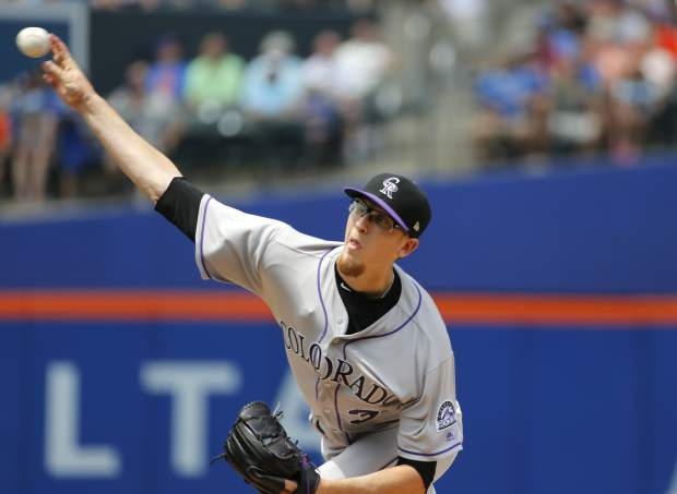Colorado Rockies starting pitcher Jeff Hoffman delivers during the first inning of a baseball game against the New York Mets, Sunday, July 16, 2017, in New York. (AP Photo/Kathy Willens)