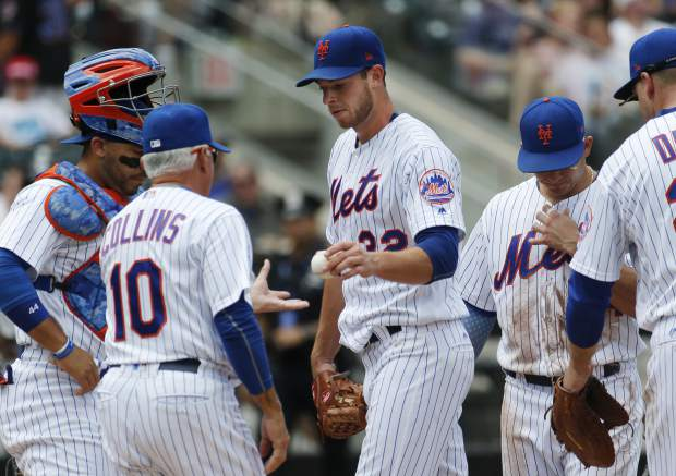 New York Mets starting pitcher Steven Matz (32) hands the ball to New York Mets manager Terry Collins (10) during the second inning of a a baseball game, Sunday, July 16, 2017, in New York. (AP Photo/Kathy Willens)