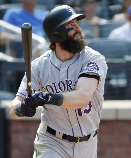 Colorado Rockies' Charlie Blackmon (19) watches his seventh-inning inside-the-park home run to center field during a baseball game against the New York Mets, Sunday, July 16, 2017, in New York. (AP Photo/Kathy Willens)