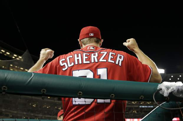 Washington Nationals' Max Scherzer cheers from the dugout during the ninth inning of the second game of a doubleheader baseball game between the Colorado Rockies and Washington Nationals, Sunday, July 30, 2017, in Washington. The Nationals won the game 3-1. (AP Photo/Mark Tenally)