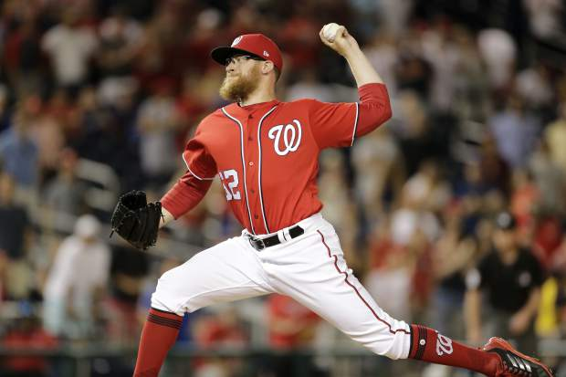 Washington Nationals relief pitcher Sean Doolittle throws the last pitch of the second game of a doubleheader baseball game against the Colorado Rockies, Sunday, July 30, 2017, in Washington. The Nationals won 3-1. (AP Photo/Mark Tenally)