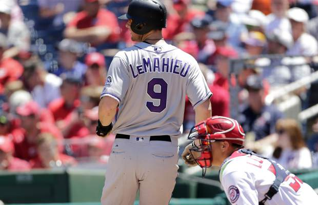 Colorado Rockies' DJ LeMahieu crosses home plate on a Raimel Tapia RBI -single during the first inning of a baseball game against the Washington Nationals, Sunday, July 30, 2017, in Washington. (AP Photo/Mark Tenally)
