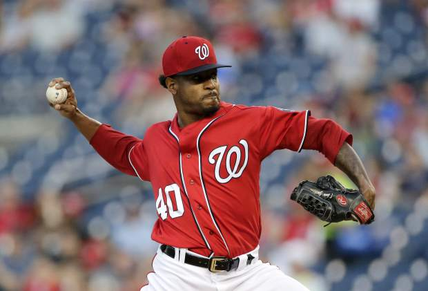 Washington Nationals starting pitcher Edwin Jackson throws during the first inning of the second game of a split doubleheader baseball game against the Colorado Rockies, Sunday, July 30, 2017, in Washington. (AP Photo/Mark Tenally)