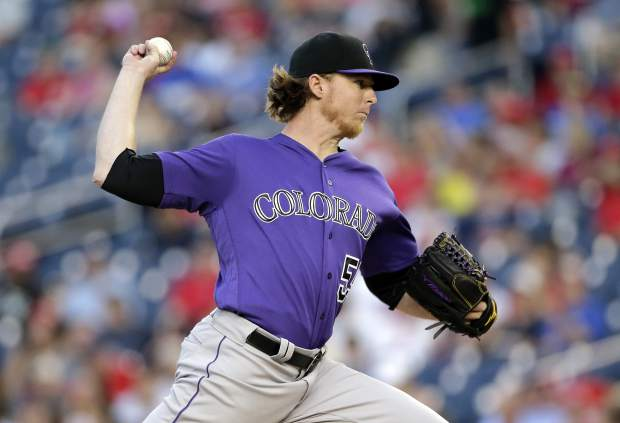 Colorado Rockies starting pitcher Jon Gray throws during the first inning of the second game of a split doubleheader baseball game between against the Washington Nationals, Sunday, July 30, 2017, in Washington. (AP Photo/Mark Tenally)