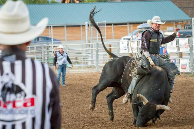 A cowboy rides an angry bull at the PRCA Pro Rodeo Xtreme Bulls portion of the 2016 Garfield County Fair and Rodeo. There were four sections with roughly 40 riders who came to Rifle from all over the country to compete in the fair.