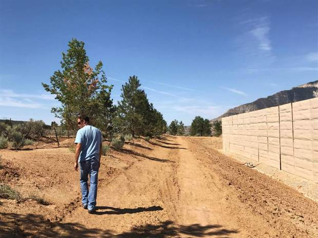 Ursa Field Land Manager John Doose shows the landscaping and sound wall that were put in at the BMC D Pad to mitigate its impact on nearby homeowners. Don Simpson, Ursa vice president of business development, added that Ursa will do more landscaping once the sound walls come down.