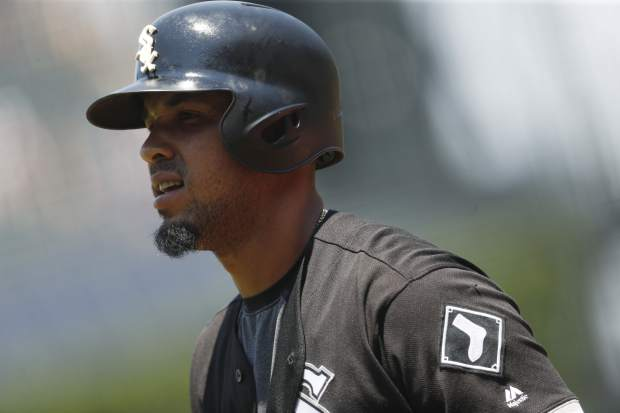 Chicago White Sox's Jose Abreu react after striking out against Colorado Rockies starting pitcher Kyle Freeland to end the top of the first inning of a baseball game Sunday, July 9, 2017, in Denver. (AP Photo/David Zalubowski)